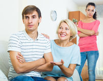 Family members trying to make it out with offended man Stock Photos