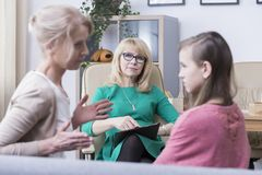 Strict mother complaining about daughter. Family mental health concept, strict critical mother complaining to the therapist about her problems with teenage stock photos