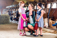 Family with milk can on cow farm Royalty Free Stock Photography