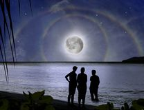 Family & miracle of moon rainbow. Paradice night Royalty Free Stock Photo