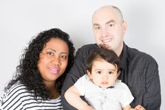 Family mixed race with child son boy standing together. Young family mixed race with child son boy standing together royalty free stock photo