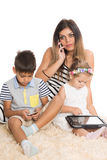 Family and modern technology Stock Images