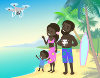 Family mom dad and children kid boy on vacation seashore ocean sea with quadcopter drone african indian brown skin. Family mother father and children kid boy on Royalty Free Stock Image