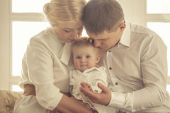 Family, mom, dad and daughter embrace together beautiful and hap Royalty Free Stock Photography
