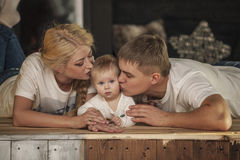 Family, mom, dad and daughter embrace together beautiful and hap Royalty Free Stock Image