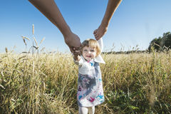 Family, mom, dad holding the daughter hands happy and beautiful Royalty Free Stock Photos