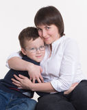 Family: Mom, dad and son in glasses. In studio Royalty Free Stock Images
