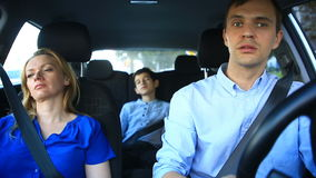 Family, mom, dad and son go in the car, mother and child sleep while traveling in the car stock footage