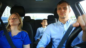 Family, mom, dad and son go in the car, mother and child sleep while traveling in the car stock video footage