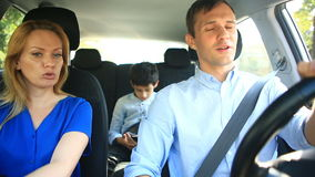 Family, mom dad and son riding in car, parents quarrel, swear at each other stock footage