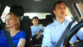 Family, mom dad and son riding in car, they sing songs with the whole family stock video