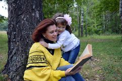 Letnic vacatireading  autumn portrait smile outdoor two son baby love nature fun father smiling daughter outdoors woman children h Stock Photo