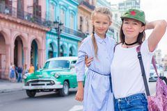 Family of mom and little in popular area in Old Havana, Cuba. Little kid and young mofther outdoors on a street of. Tourist girl and mother in popular area in stock images