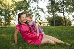 Family. Mom pregnant and daughter outdoors Stock Photo