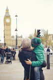A family of mom and son are looking at Big Ben Stock Image
