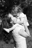 Family moments. Mother and her daugher have a fun in park - black and white photo with red filter effect royalty free stock images