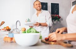 Family moments concept image - married prepare meal together Stock Photos