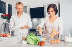 Family moments concept image - married prepare meal together Stock Images