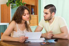 Family with money and documents. In living room royalty free stock photography