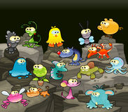 Family of monsters in the cave. Funny cartoon and vector  characters Royalty Free Stock Photo