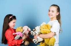 Family is the most important thing. small girls with soft bear toys. toy shop. childrens day. playground. little sisters. Girls playing game in playroom. happy royalty free stock photography