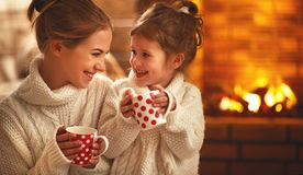 Free Family Mother And Child Drinking Tea And Laughing On Winter Even Royalty Free Stock Photo - 107835145