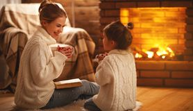 Free Family Mother And Child Reading Book On Winter Evening By Fireplace. Royalty Free Stock Photos - 108120308
