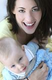 Family: Mother and Baby. Young mother holding her baby son, suitable for a variety of family, parenting, motherhood, childhood themes Stock Photo
