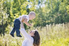 Family mother and baby happy and beautiful with smiles together stock images