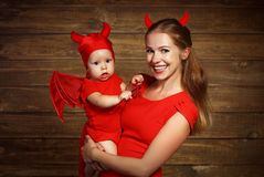 Family mother and baby son celebrate Halloween in devil costume Royalty Free Stock Photos