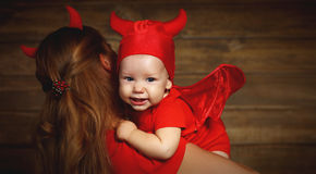 Family mother and baby son celebrate Halloween in devil costume Royalty Free Stock Photo