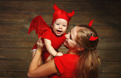 Family mother and baby son celebrate Halloween in devil costume Royalty Free Stock Images