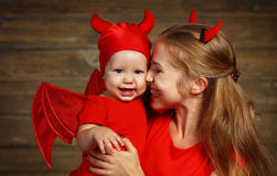Family mother and baby son celebrate Halloween in devil costume Royalty Free Stock Image