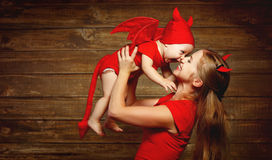 Family mother and baby son celebrate Halloween in devil costume. Family fun mother and baby son having fun and celebrate Halloween in devil costume stock image
