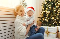 Family mother and baby son at Christmas morning at tree Stock Photo