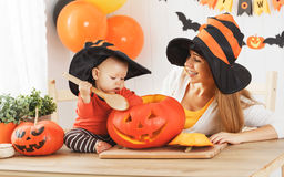 Family mother and baby son are preparing for Halloween carve a p Stock Photography