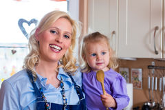 Family - mother and child baking pizza Stock Photos