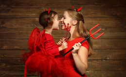 Family mother and child daughter celebrate Halloween in devil co Royalty Free Stock Image