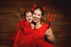 Family mother and child daughter celebrate Halloween in devil co Royalty Free Stock Images