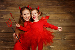 Family mother and child daughter celebrate Halloween in devil co Royalty Free Stock Photos