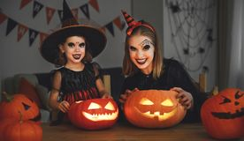Family mother and child daughter in costumes and makeup to hallo royalty free stock image