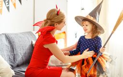 Family mother and child   daughter getting ready for halloween, Royalty Free Stock Photo