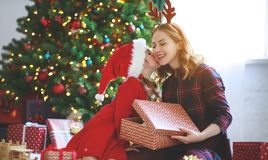 Family mother and child daughter open presents on Christmas mo royalty free stock image