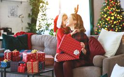 Family mother and child daughter open presents on Christmas mo stock photo