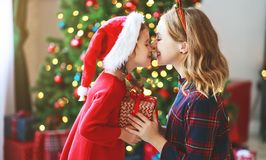 Family mother and child daughter open presents on Christmas mo royalty free stock photos