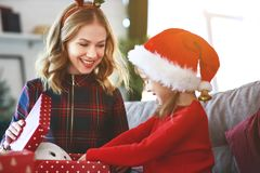 Family mother and child daughter open presents on Christmas mo royalty free stock photography