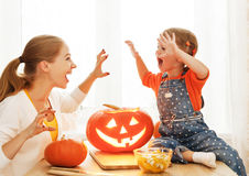 Family mother and child daughter are preparing for Halloween car Stock Photos