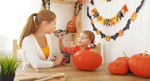 Family mother and child daughter are preparing for Halloween car Royalty Free Stock Photo