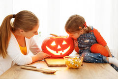 Family mother and child daughter are preparing for Halloween car Stock Photography