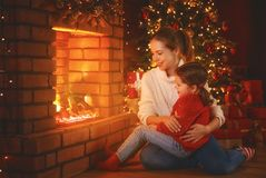 Family mother and child  daughter watching   fireplace at Christ Stock Image
